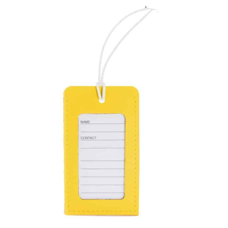 Keltainen uusionahkainen nimilappu matkalaukkuun.