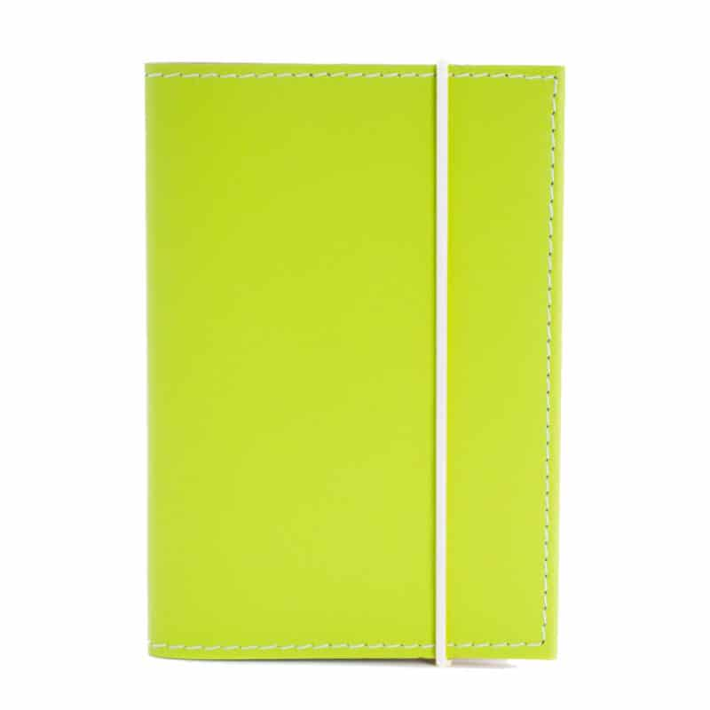 Lime passport cover made of regenerated leather.