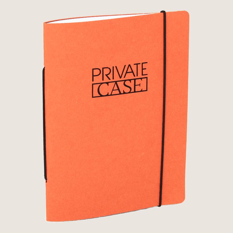 Oranssi uusiopahvinen Unlimited Notes -muistivihko.