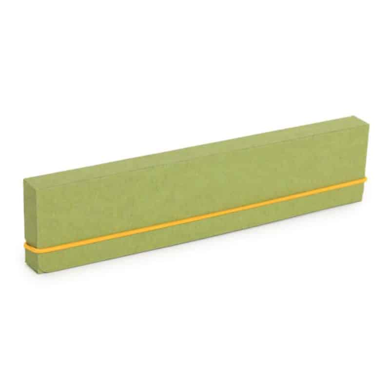 Green pencil case made of recycled cardboard.